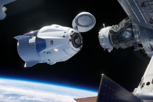 Space station crew returns home